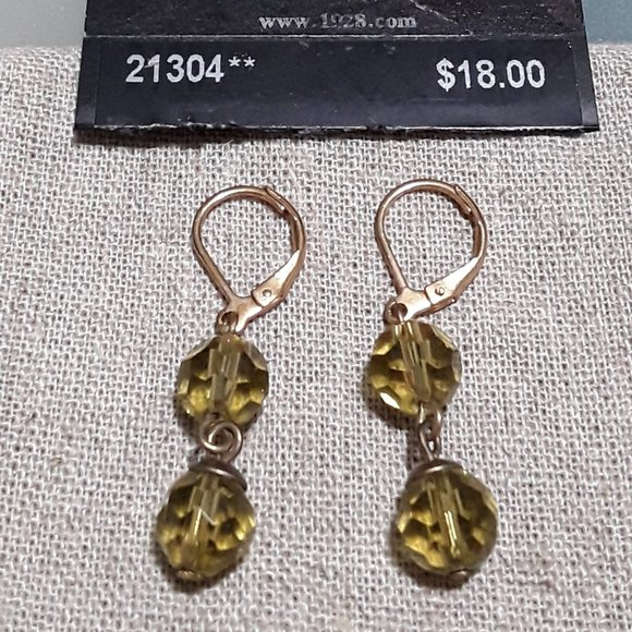 Gold colored with light green clip on earrings